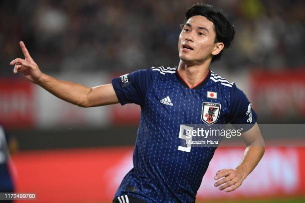 Takumi Minamino of Japan celebrates after scoring the second goal during the international friendly match between Japan and Paraguay at Kashima...