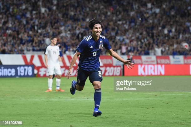 Takumi Minamino of Japan celebrates scoring a goal during the international friendly match between Japan and Costa Rica at Suita City Football...