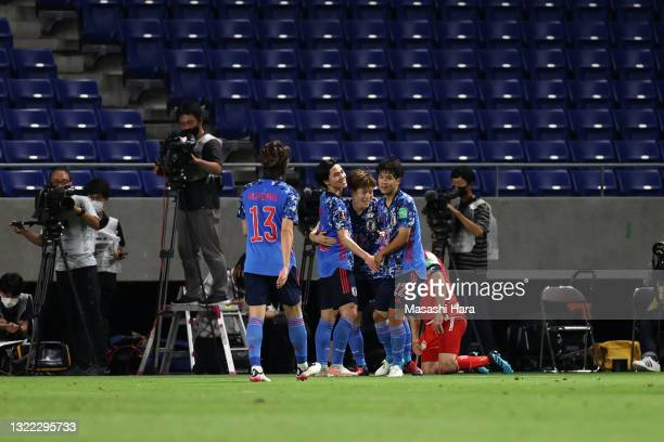 Takumi Minamino of Japan celebrates scoring his side's second goal with his team mates during the FIFA World Cup Asian Qualifier 2nd round Group F...
