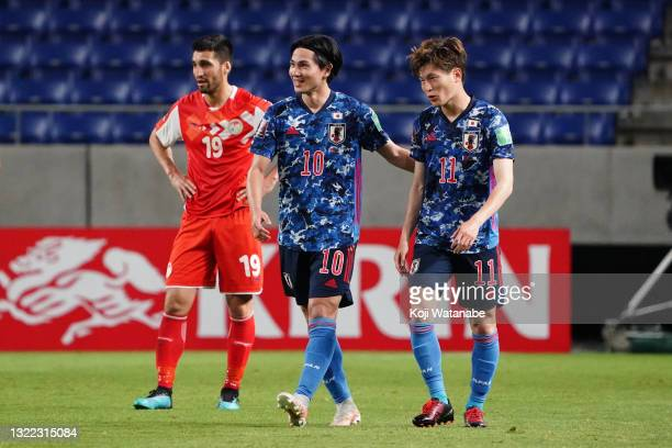 Takumi Minamino of Japan celebrates scoring his side's second goal with his team mate Kyogo Furuhashi during the FIFA World Cup Asian Qualifier 2nd...