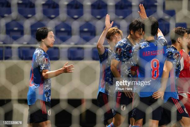 Takumi Minamino of Japan celebrates scoring his side's second goal during the FIFA World Cup Asian Qualifier 2nd round Group F match between Japan...