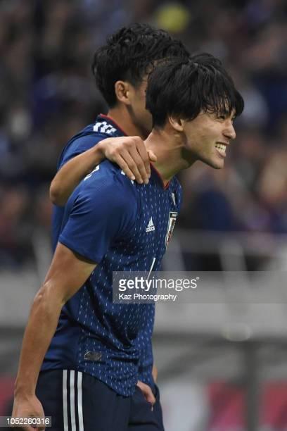 Takumi Minamino of Japan celebrates the opner during the international friendly match between Japan and Uruguay at Saitama Stadium on October 16 2018...