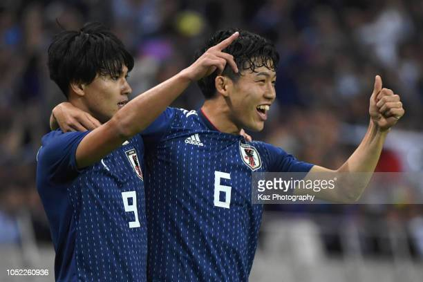 Takumi Minamino of Japan celebrates the opner with his team mate Wataru Endo of Japan during the international friendly match between Japan and...