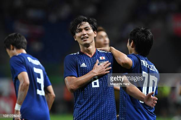 Takumi Minamino of Japan celebrates the second goal during the international friendly match between Japan and Costa Rica at Suita City Football...