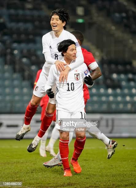 Takumi Minamino of Japan celebrates with Genki Haraguchi of Japan after scoring his team's first goal during the international friendly match between...