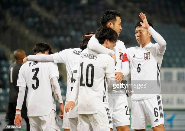 Takumi Minamino of Japan celebrates with teammates after scoring his team's first goal during the international friendly match between Japan and...
