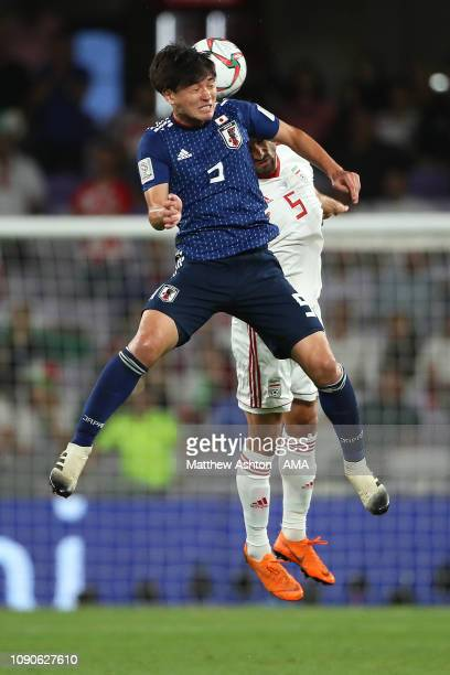 Takumi Minamino of Japan competes with Milad Mohammadikeshmarzi of Iran during the AFC Asian Cup semi final match between Iran and Japan at Hazza Bin...