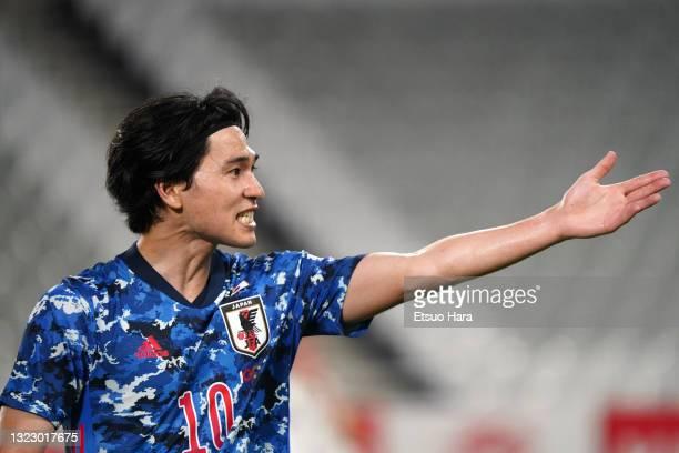 Takumi Minamino of Japan gestures during the international friendly match between Japan and Serbia at Noevir Stadium Kobe on June 11, 2021 in Kobe,...