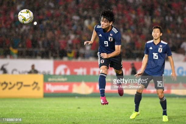 Takumi Minamino of Japan heads to score his side's second goal during the FIFA World Cup Asian Qualifier between Myanmar and Japan at Thuwanna...