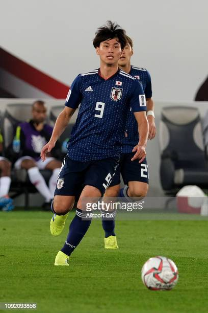 Takumi Minamino of Japan in action during the AFC Asian Cup final match between Japan and Qatar at Zayed Sports City Stadium on February 1 2019 in...