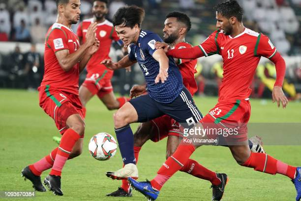 Takumi Minamino of Japan in action during the AFC Asian Cup Group F match between Oman and Japan at Zayed Sports City Stadium on January 13 2019 in...