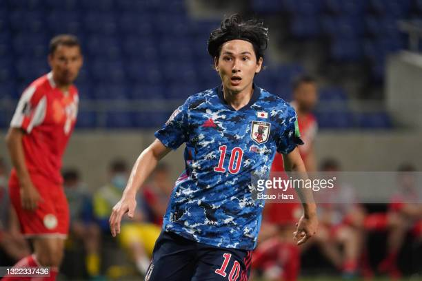 Takumi Minamino of Japan in action during the FIFA World Cup Asian Qualifier 2nd round Group F match between Japan and Tajikistan at Panasonic...