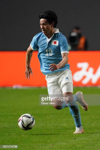 Takumi Minamino of Japan in action during the friendly match between Japan and Japan U-24 at the Sapporo Dome on June 3, 2021 in Sapporo, Hokkaido,...