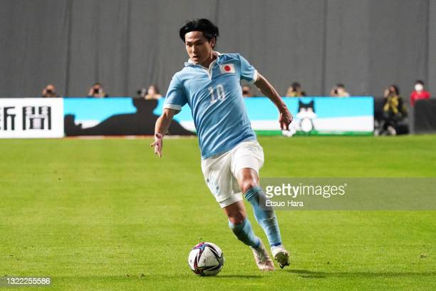 Takumi Minamino of Japan in action during the friendly match between Japan and Japan U-24 at the Sapporo Dome on June 03, 2021 in Sapporo, Hokkaido,...