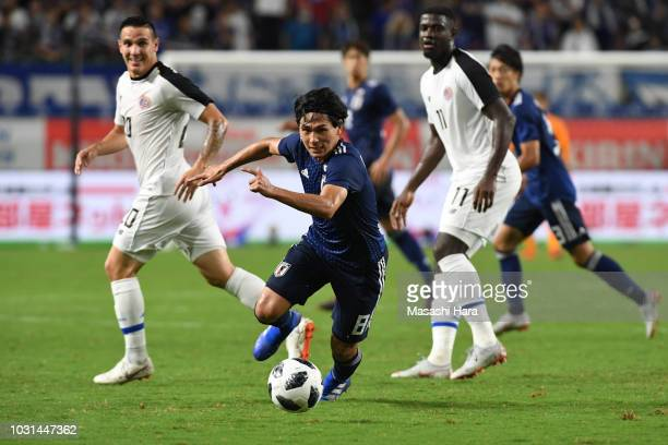 Takumi Minamino of Japan in action during the international friendly match between Japan and Costa Rica at Suita City Football Stadium on September...