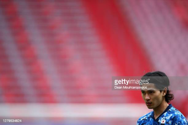 Takumi Minamino of Japan in action during the international friendly match between Japan and Cameroon at Stadion Galgenwaard on October 09, 2020 in...