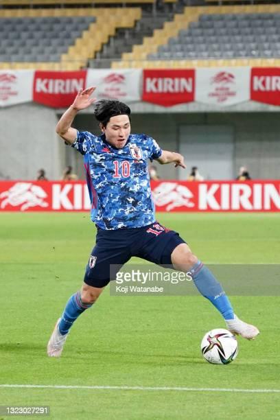 Takumi Minamino of Japan in action during the international friendly match between Japan and Serbia at Noevir Stadium Kobe on June 11, 2021 in Kobe,...