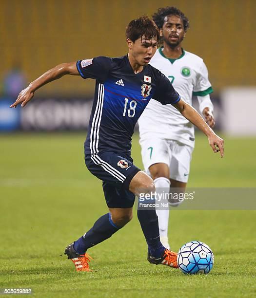 Takumi Minamino of Japan is chased by Abdulmajeed Alsulayhim of Saudi Arabia during the AFC U23 Championship Group B match between Saudi Arabia and...