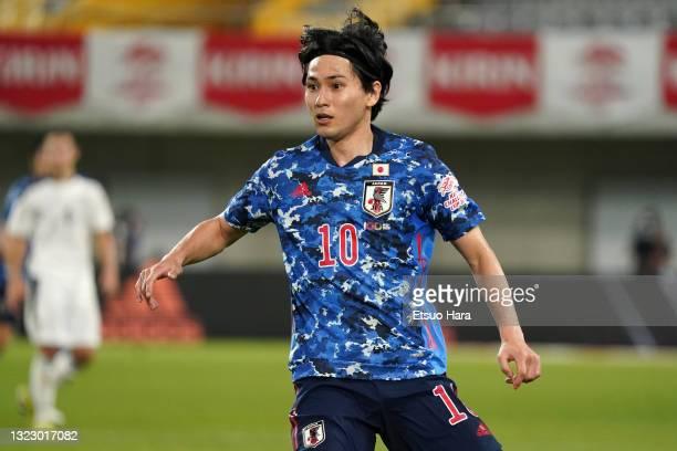Takumi Minamino of Japan is seen during the international friendly match between Japan and Serbia at Noevir Stadium Kobe on June 11, 2021 in Kobe,...