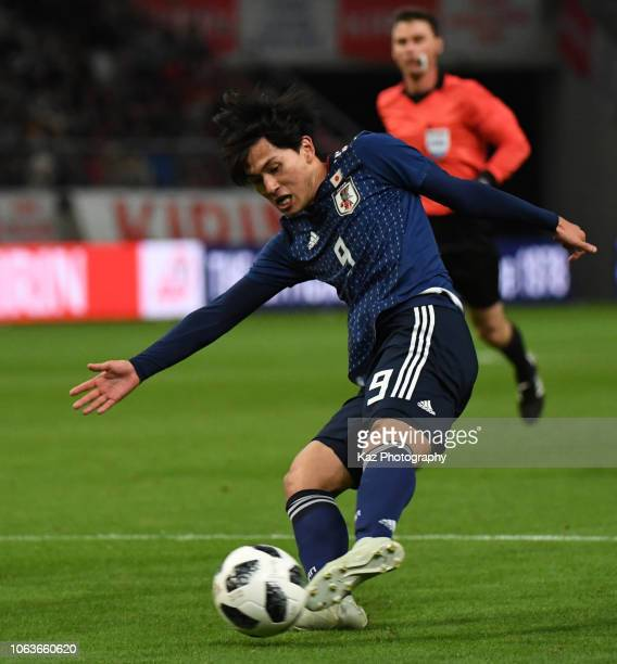 Takumi Minamino of Japan kicks the ball during the international friendly match between Japan and Kyrgyz at Toyota Stadium on November 20 2018 in...