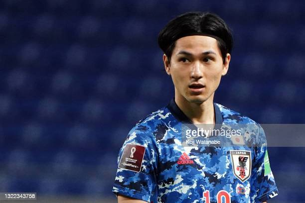 Takumi Minamino of Japan looks on during the FIFA World Cup Asian Qualifier 2nd round Group F match between Japan and Tajikistan at Panasonic Stadium...
