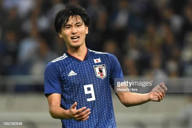 Takumi Minamino of Japan looks on during the international friendly match between Japan and Uruguay at Saitama Stadium on October 16 2018 in Saitama...
