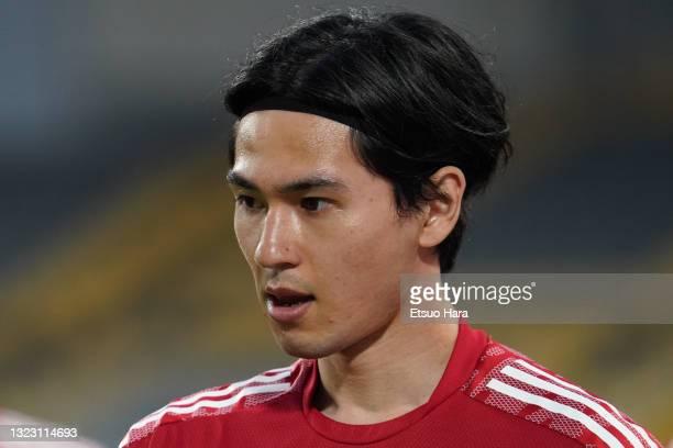 Takumi Minamino of Japan looks on prior to the international friendly match between Japan and Serbia at Noevir Stadium Kobe on June 11, 2021 in Kobe,...