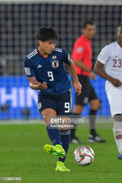 Takumi Minamino of Japan passes the ball during the AFC Asian Cup final match between Japan and Qatar at Zayed Sports City Stadium on February 01...