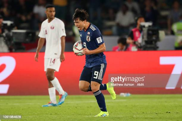 Takumi Minamino of Japan reacts after scoring a goal to make it 12 during the AFC Asian Cup final match between Japan and Qatar at Zayed Sports City...