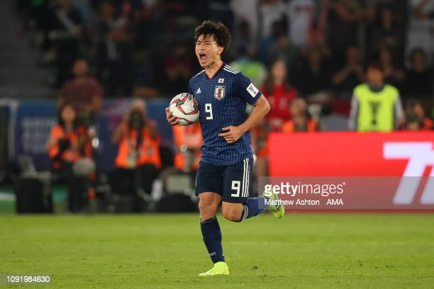 Takumi Minamino of Japan reacts after scoring a goal to make it 1-2 during the AFC Asian Cup final match between Japan and Qatar at Zayed Sports City...
