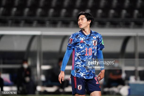 Takumi Minamino of Japan reacts during the FIFA World Cup Asian qualifier second round match between Japan and Myanmar at Fukuda Denshi Arena on May...