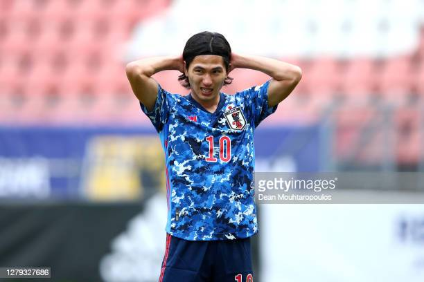 Takumi Minamino of Japan reacts during the international friendly match between Japan and Cameroon at Stadion Galgenwaard on October 09, 2020 in...