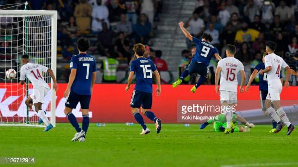Takumi Minamino of Japan scores his side7s first goal during the AFC Asian Cup final match between Japan and Qatar at Zayed Sports City Stadium on...