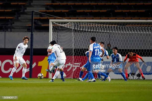 Takumi Minamino of Japan scores his side's first goal during the FIFA World Cup Asian Qualifier second round between Mongolia and Japan at Fukuda...