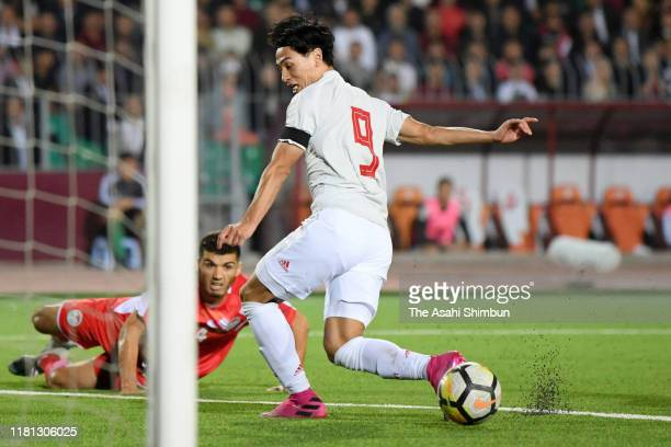 Takumi Minamino of Japan scores his side's second goal during the FIFA World Cup Asian Qualifier second round Group F match between Tajikistan and...