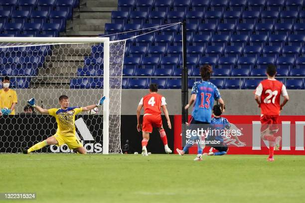 Takumi Minamino of Japan scores his side's second goal during the FIFA World Cup Asian Qualifier 2nd round Group F match between Japan and Tajikistan...