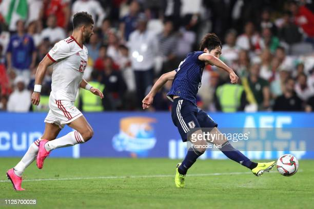 Takumi Minamino of Japan scores his sides third goal during the AFC Asian Cup semi final match between Iran and Japan at Hazza Bin Zayed Stadium on...