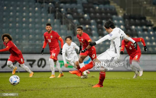 Takumi Minamino of Japan scores his team's first goal from a penalty during the international friendly match between Japan and Panama at Merkur Arena...