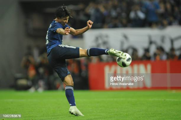 Takumi Minamino of Japan scores his team's fiurth goal during the international friendly match between Japan and Uruguay at Saitama Stadium on...