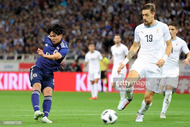 Takumi Minamino of Japan scores the opening goal during the international friendly match between Japan and Uruguay at Saitama Stadium on October 16...
