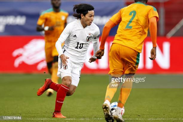 Takumi Minamino of Japan, Sinaly Diomande or Ivory Coast during the friendly match between Japan and Ivory Coast at Stadium Galgenwaard on October...