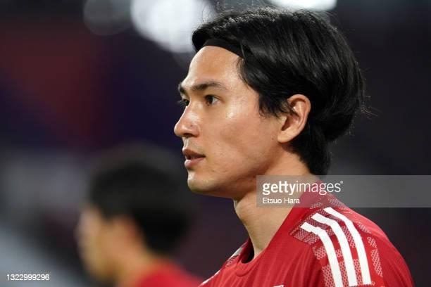 Takumi Minamino of Japan warms up prior to the international friendly match between Japan and Serbia at Noevir Stadium Kobe on June 11, 2021 in Kobe,...