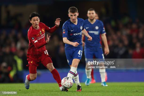 Takumi Minamino of Liverpool and Billy Gilmour of Chelsea during the FA Cup Fifth Round match between Chelsea FC and Liverpool FC at Stamford Bridge...