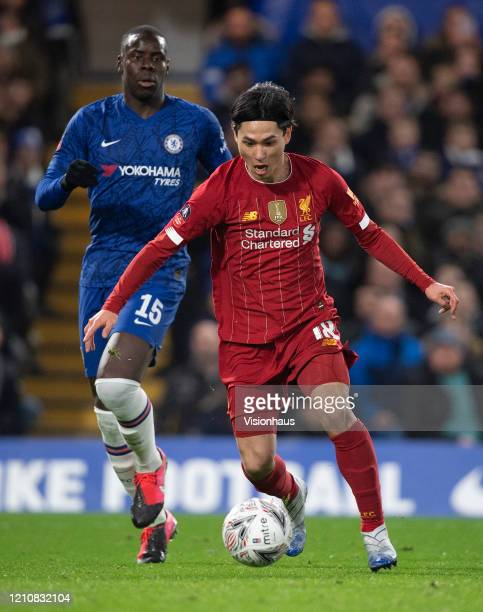 Takumi Minamino of Liverpool and Kurt Zouma during the FA Cup Fifth Round match between Chelsea FC and Liverpool FC at Stamford Bridge on March 03...