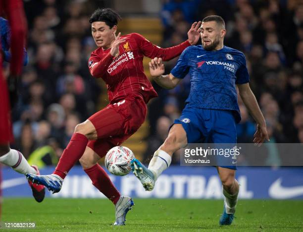 Takumi Minamino of Liverpool and Mateo Kovacic of Chelsea during the FA Cup Fifth Round match between Chelsea FC and Liverpool FC at Stamford Bridge...