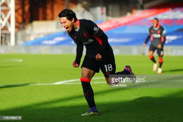 Takumi Minamino of Liverpool celebrates after scoring their sides first goal during the Premier League match between Crystal Palace and Liverpool at...