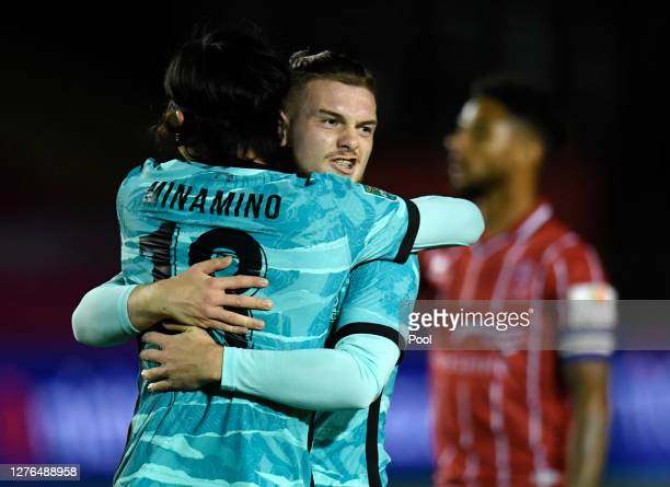 Takumi Minamino of Liverpool celebrates with Harvey Elliott of Liverpool after scoring his teams second goal during the Carabao Cup third round match...