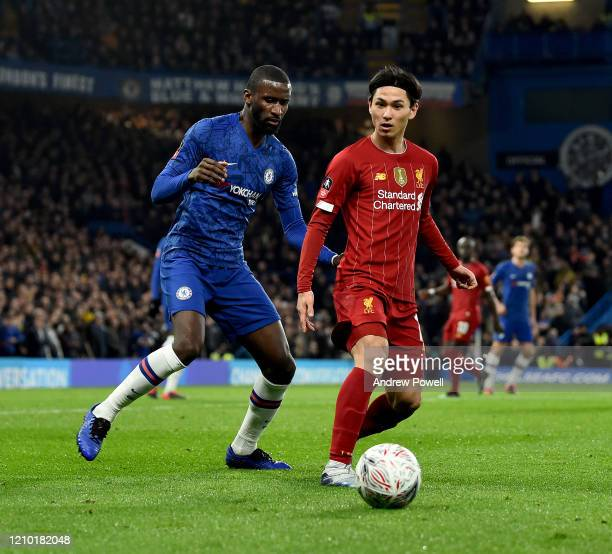 Takumi Minamino of Liverpool competing with Antonio Rudiger of Chelsea during the FA Cup Fifth Round match between Chelsea FC and Liverpool FC at...