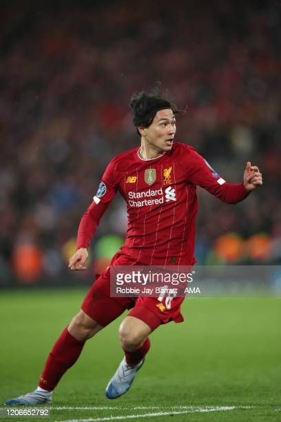 Takumi Minamino of Liverpool during extra time of the UEFA Champions League round of 16 second leg match between Liverpool FC and Atletico Madrid at...