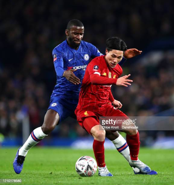 Takumi Minamino of Liverpool FC and Antonio Rudiger of Chelsea FC in action during the FA Cup Fifth Round match between Chelsea FC and Liverpool FC...